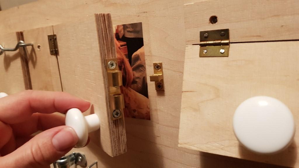 busy board doors latch