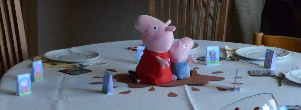 peppa pig in muddy puddle