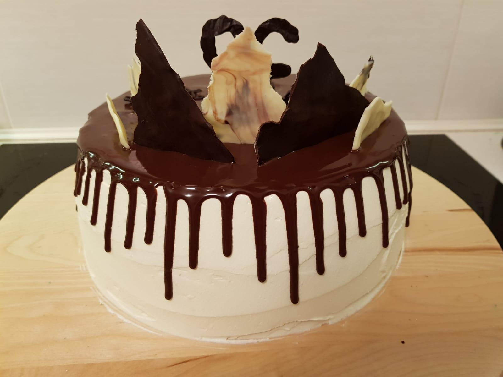 checkerboard drip cake behind