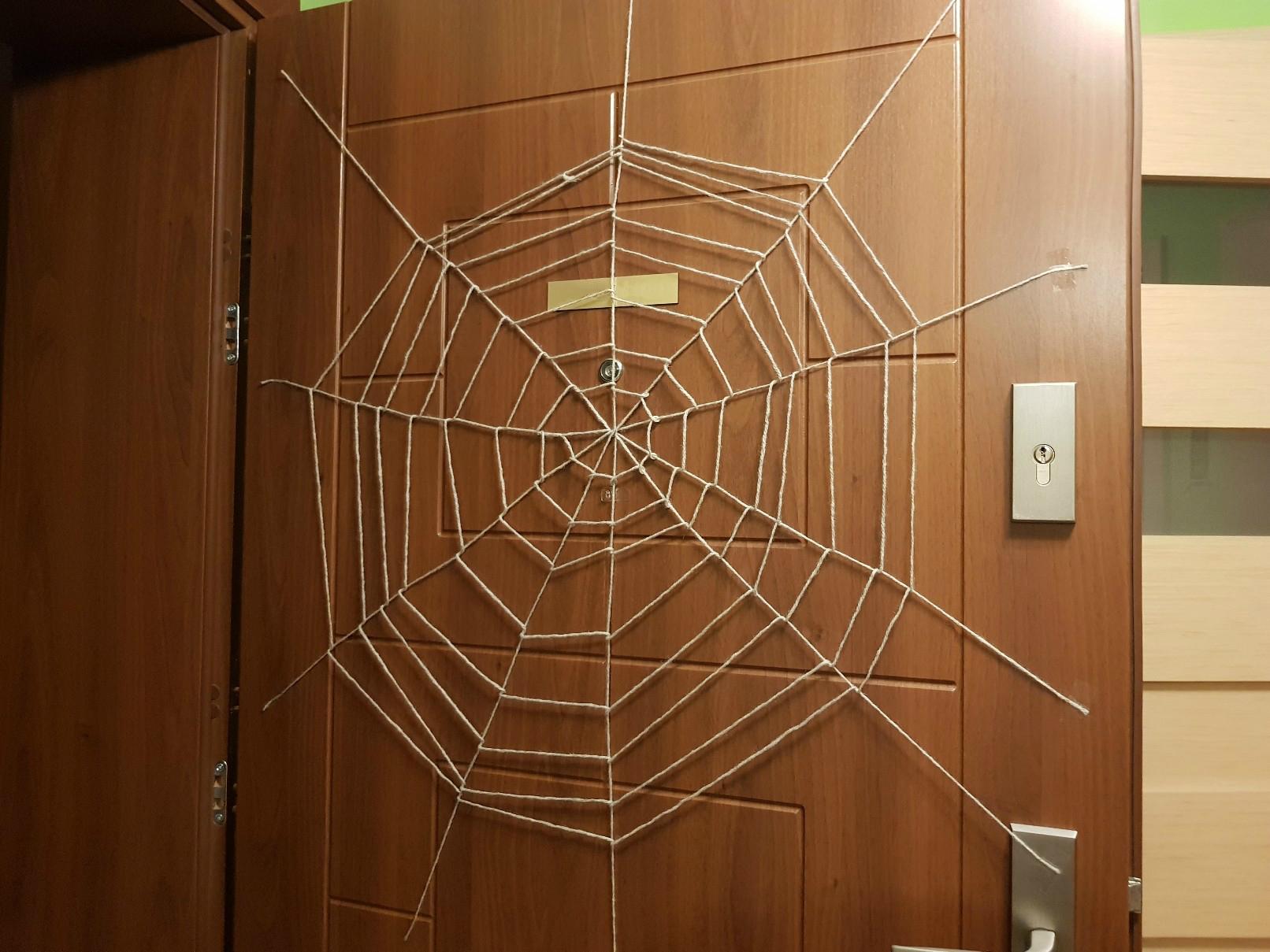 halloween spiders web on the door