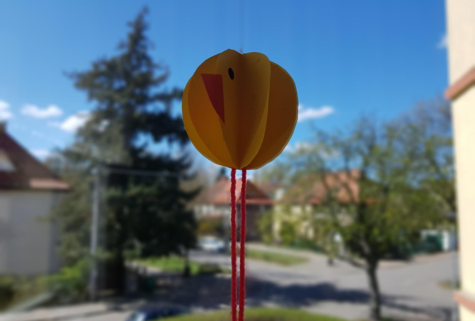 yellow round chicken on window