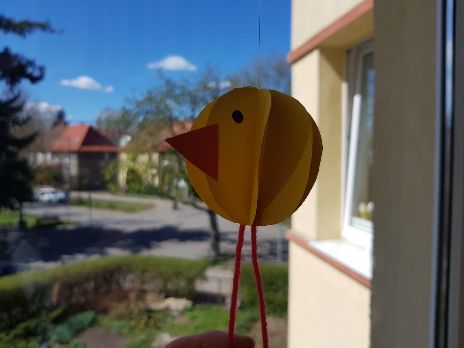 yellow round chicken side on window